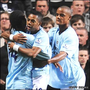 Robinho celebrates his early penalty for Manchester City