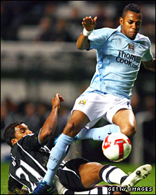 Robinho is challenged by Newcastle's Habib Beye