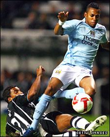 Robinho is challenged by Newcastle's Habib Beye