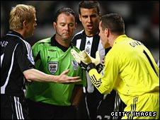 Newcastle players surround Rob Styles