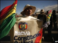 """A supporter of President Morales wearing a costume bearing the words """"New Constitution""""  on 20 October"""