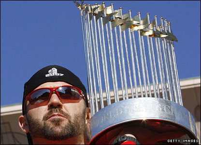 Boston's Jason Varitek, captain of the 2007 World Series-winning Red Sox, with the trophy
