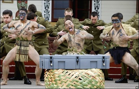Maori warriors and New Zealand army members perform Haka