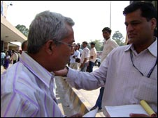Mr Moitra (left) being fined by a member of the anti-smoking squad