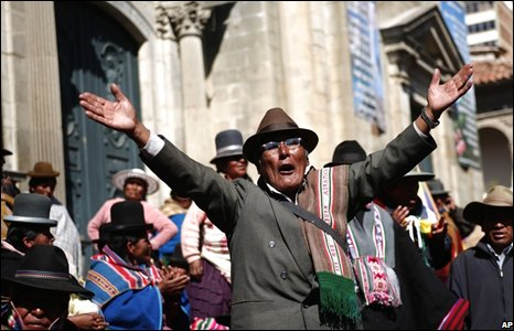 A supporter of Bolivian President Evo Morales celebrates outside the congress in La Paz