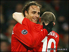 Dimitar Berbatov celebrates his second goal with Wayne Rooney