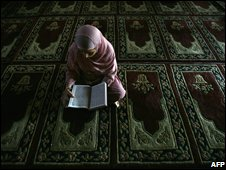 Muslim girl reading the Koran