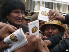 President Morales is besieged by supporters carrying copies of the draft constitution