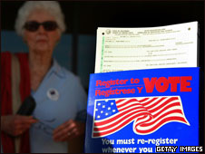 A voter looks at a voter registration form in California, 20 Oct