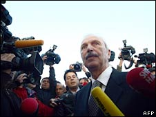 One of the defendants arrives at the courtroom for the trial. Photo: 20 October 2008