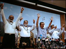 Scientists applauding the launch
