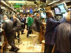 A row of traders at the NYSE