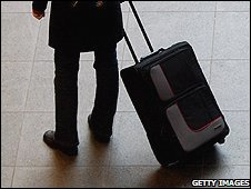 Person with suitcase (file image)