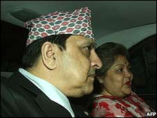 Former king Gyanendra of Nepal leaves the palace in Kathmandu with his wife Komal