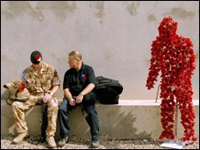 Chris Simpkins, Director General The Royal British Legion with a British soldier