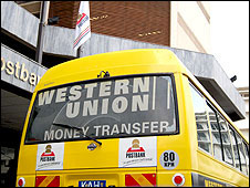 Minibus taxi in Kenya with advert for Western Union