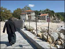 A monk walks towards the monastic community of Mount Athos. Photo: October 2008