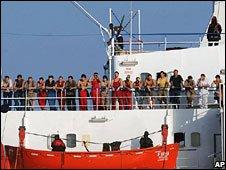 Pirates guard the crew on the MV Faina