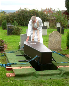 Chaplain touching coffin