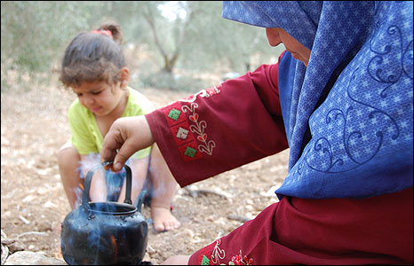 Um Nimer Shtawie makes tea during olive harvest