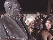 Tracy and Charlotte Dawson with statue