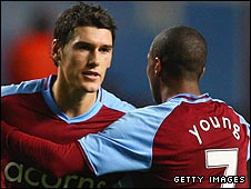 Goalscorer Gareth Barry is congratulated by Ashley Young