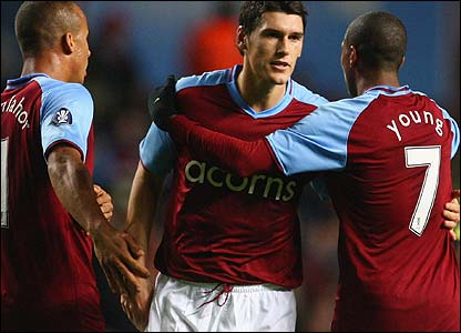Gabriel Agbonlahor (l), Gareth Barry and Luke Young