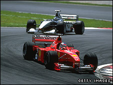 Michael Schumacher leads Mika Hakkinen during the 1999 Malaysian Grand Prix