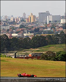 A Ferrari races past the Sao Paulo skyline at the 2007 Brazilian Grand Prix