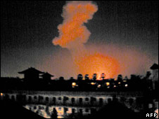Fire rises above Bali after the explosions on 12/10/2002