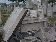 Vandalised gravestone in Jewish cemetery, Bucharest
