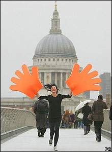 "Londoner Jenny Richards raises her ""hands"" in support of World Vision School Aid on Millennium Bridge"