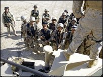 Iraqi soldiers listening to a US soldier