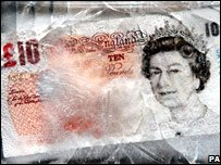 Ten pound note frozen in ice