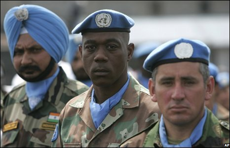 UN soldiers from India, (L), South Africa, (C), and Uruguay, during a celebration of United Nations day in Goma, eastern Congo
