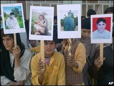 Demonstrators hold four portraits of the slain young men during an anti-Taleban rally