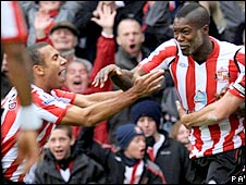 Djibril Cisse (r) celebrates his goal with Anton Ferdinand