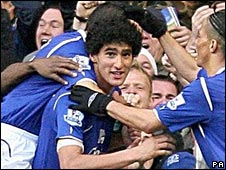 Marouane Fellaini celebrates after heading Everton level