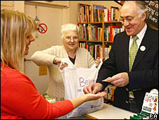 Michael Howard serves a customer