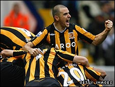 Hull celebrate on their way to another Premier League victory
