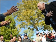 John McCain bows as he acknowledges supporters in Albuquerque, New Mexico