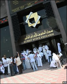 Trader soutside the Kuwait Stock Exchange (Oct 23)