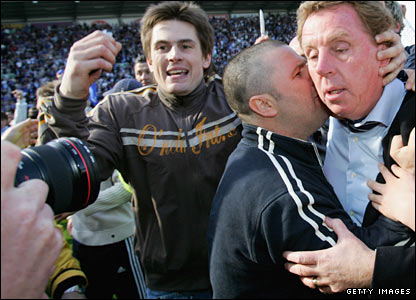 Harry Redknapp celebrates with fans at Wigan