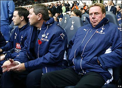 New Spurs manager Harry Redknapp takes his place on the bench