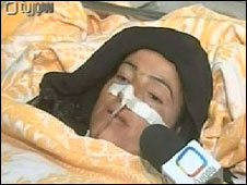 A woman apparently injured in the attack (still taken from Syrian TV)