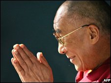 Tibetan spiritual leader the Dalai Lama gestures as he greets a group of well-wishers, New Delhi, Oct 2008