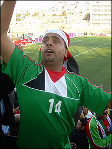 Fayaz Kattoush leads singing at Palestinian national football match