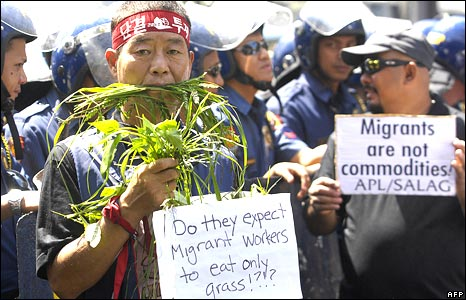 Protests outside a migration forum in Manila, Philippines