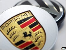 Volkswagen and Porsche signs