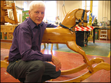 Liam Maidment with a rocking horse made by offenders